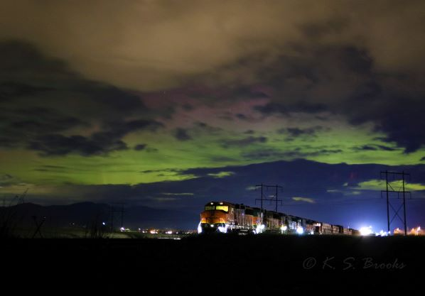 train at night under aurora borealis flash fiction writing prompt photo